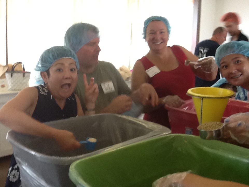 Church members having fun at all-church food packing event