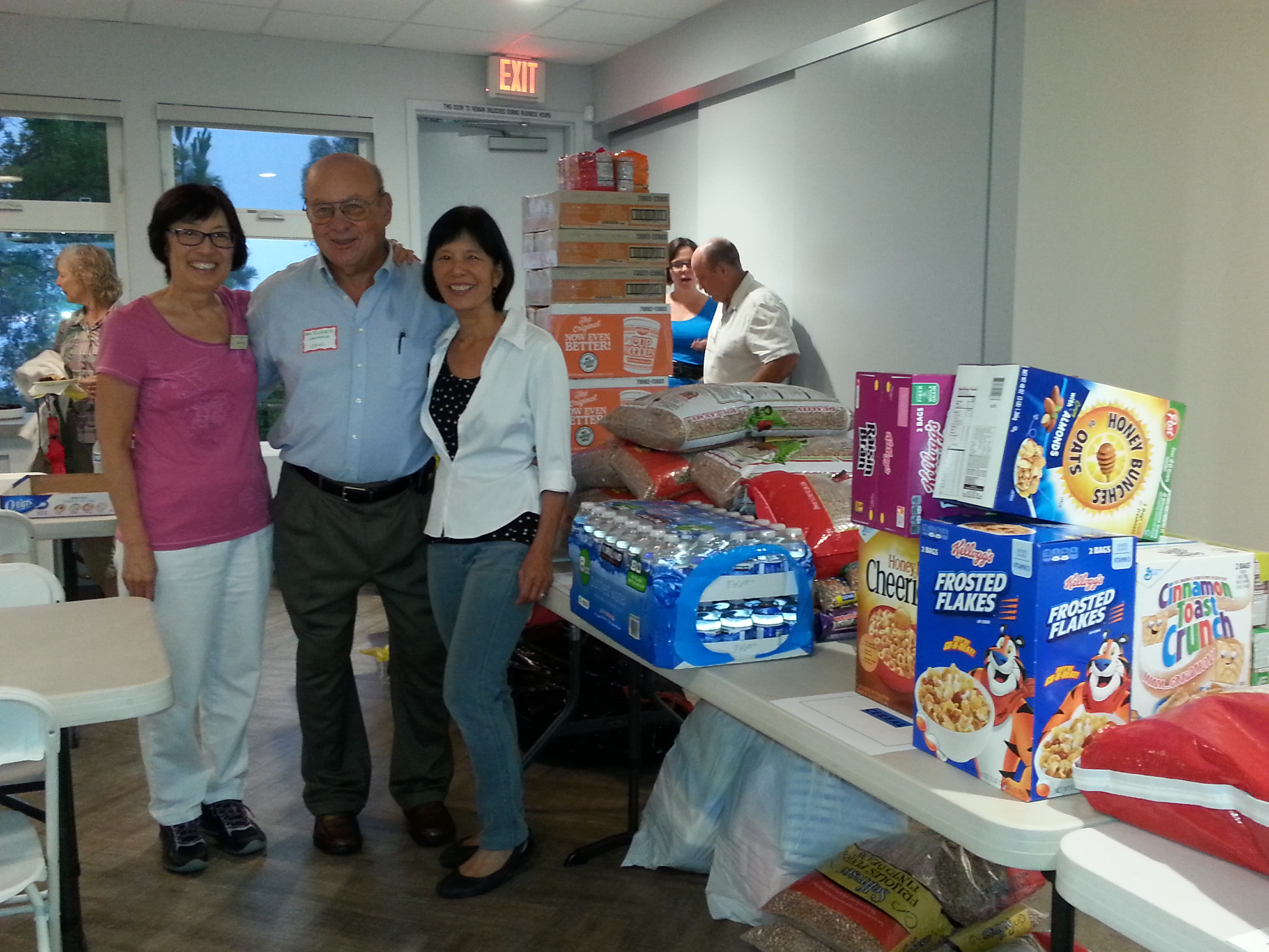 POVUCC members with food collected for Haitian refugees