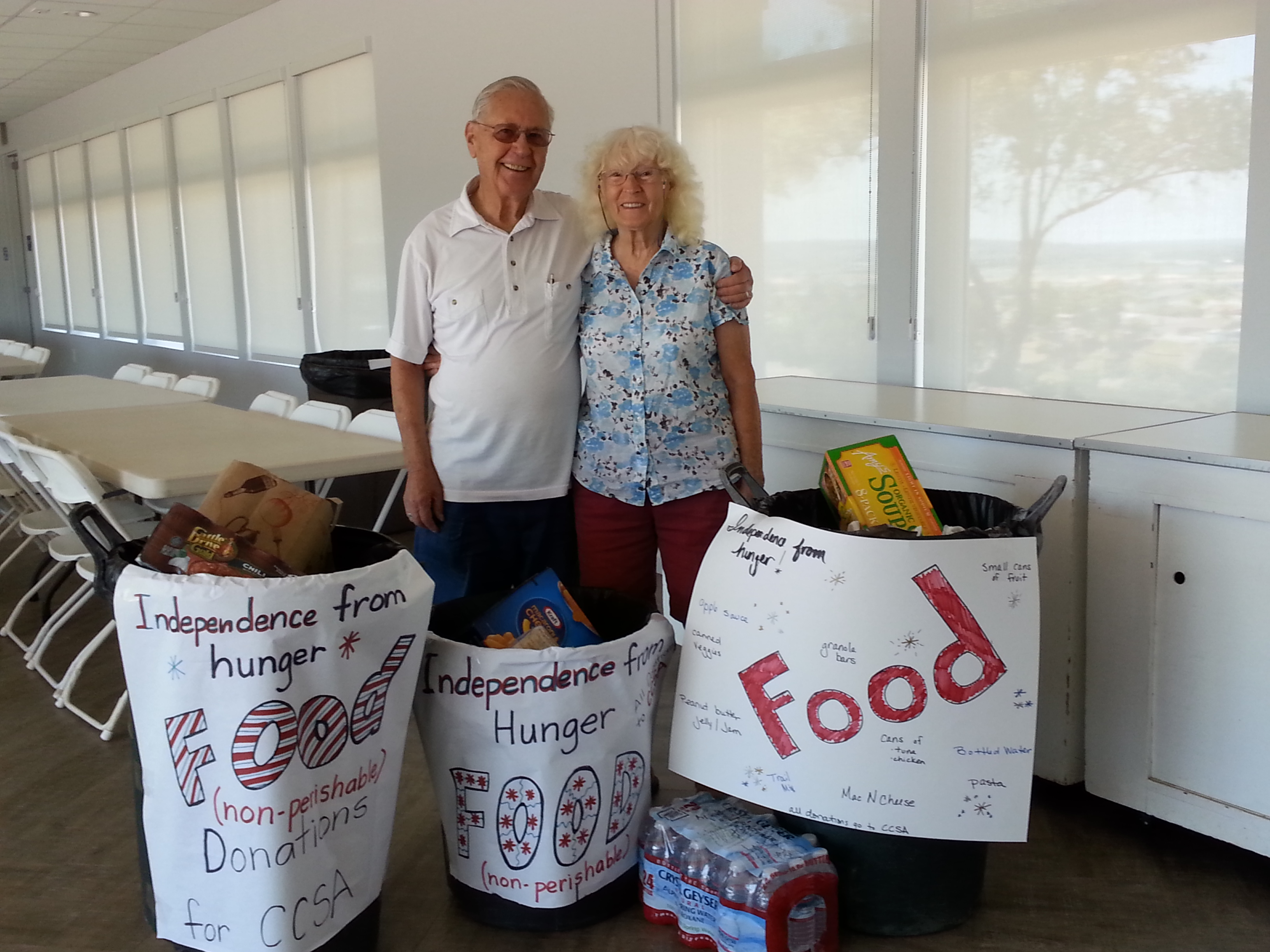 Members posing with food collected for CCSA